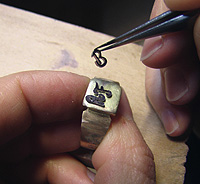 Kerstin Laibach solders new handcut letters onto ring