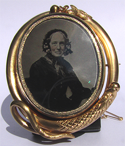 Victorian swivel snake brooch with deguerreotype photo.